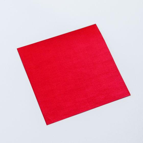 Rødt papir til indpakning af julegodterne.